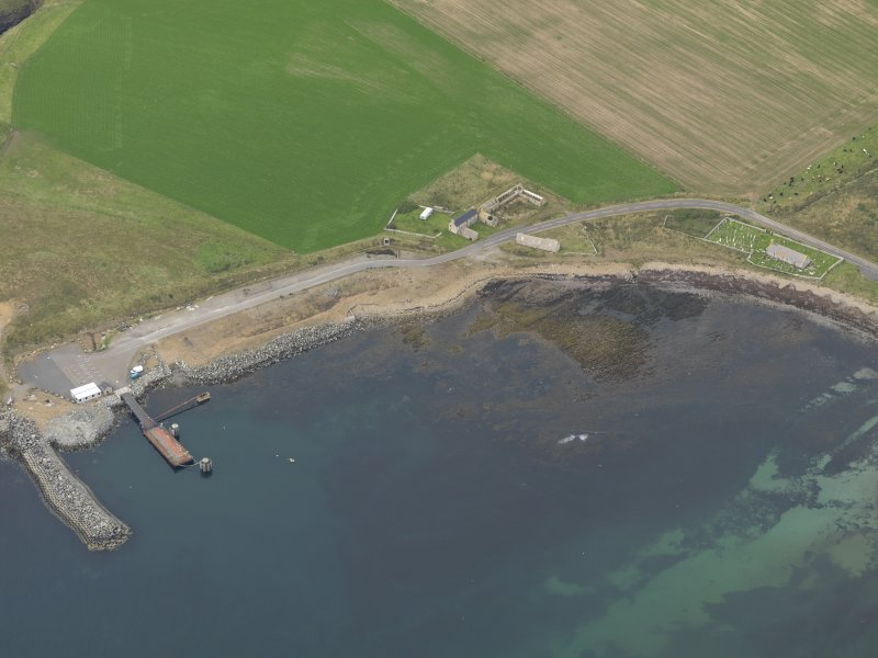 Oblique aerial view centred on the ferry terminal with the farmstead adjacent, taken from the S.