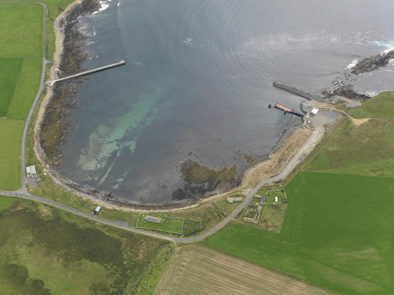 Oblique aerial view centred on the farmstead with the ferry terminal adjacent, taken from the N.