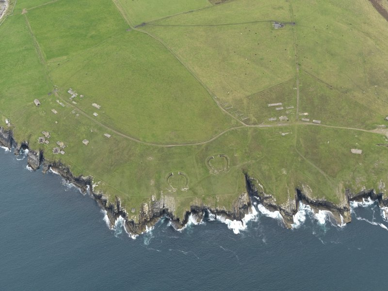 General oblique aerial view centred on the coastal gun batteries, taken from the WSW.