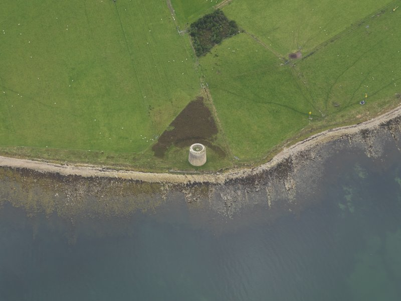 Oblique aerial view centred on the Martello Tower, taken from the E.