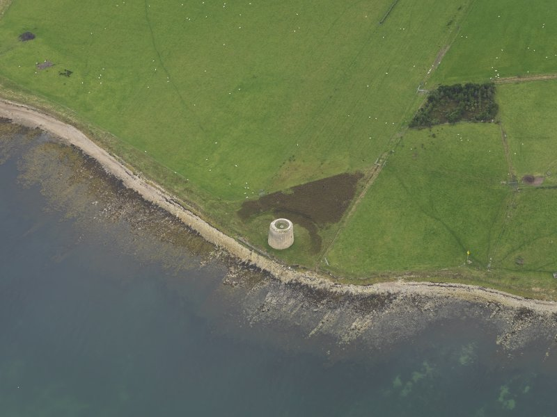 Oblique aerial view centred on the Martello Tower, taken from the ENE.