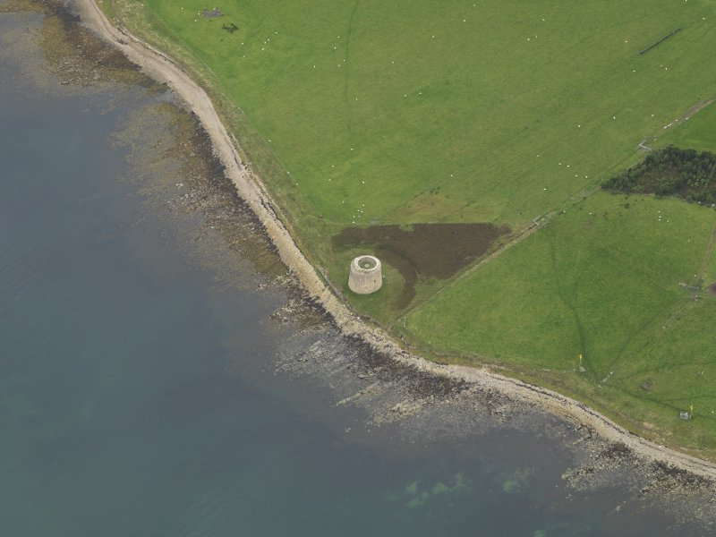 Oblique aerial view centred on the Martello Tower, taken from the NE.