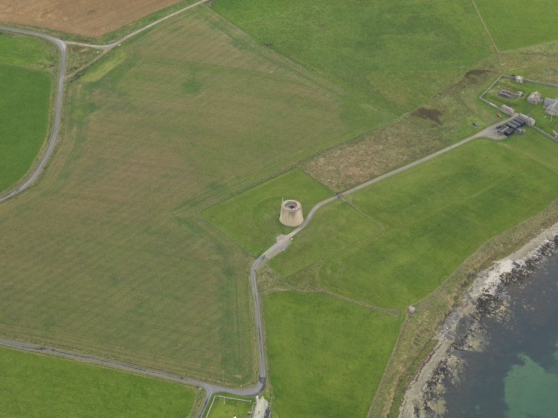 Oblique aerial view centred on the Martello Tower, taken from the SSE.