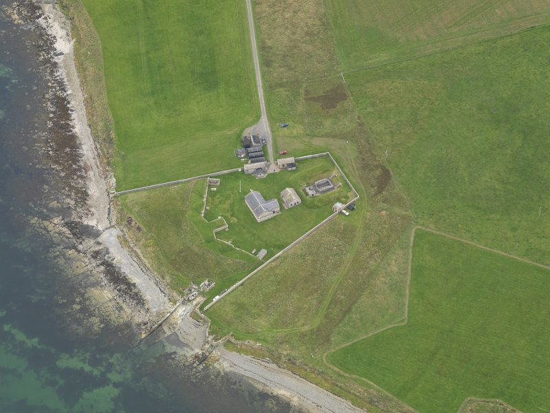 Oblique aerial view centred on the early 19th century gun battery, taken from the NW.