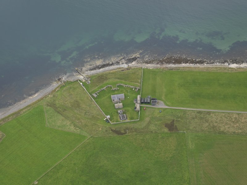 Oblique aerial view centred on the early 19th century gun battery, taken from the SW.