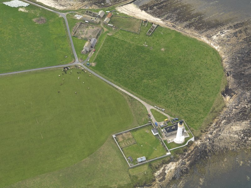 General oblique aerial view centred on the lighthouse, taken from the SE.