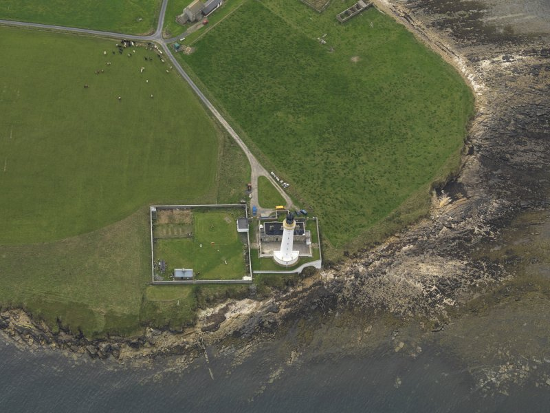 Oblique aerial view centred on the lighthouse, taken from the E.