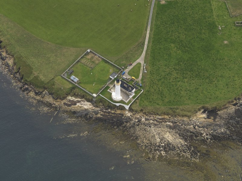 Oblique aerial view centred on the lighthouse, taken from the NE.
