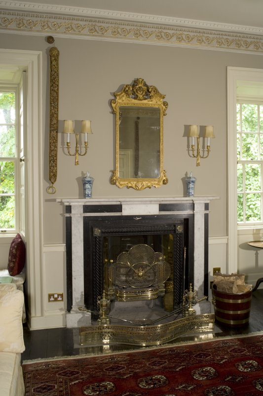 Interior. 1st floor, drawing room, view of fireplace with mirror above