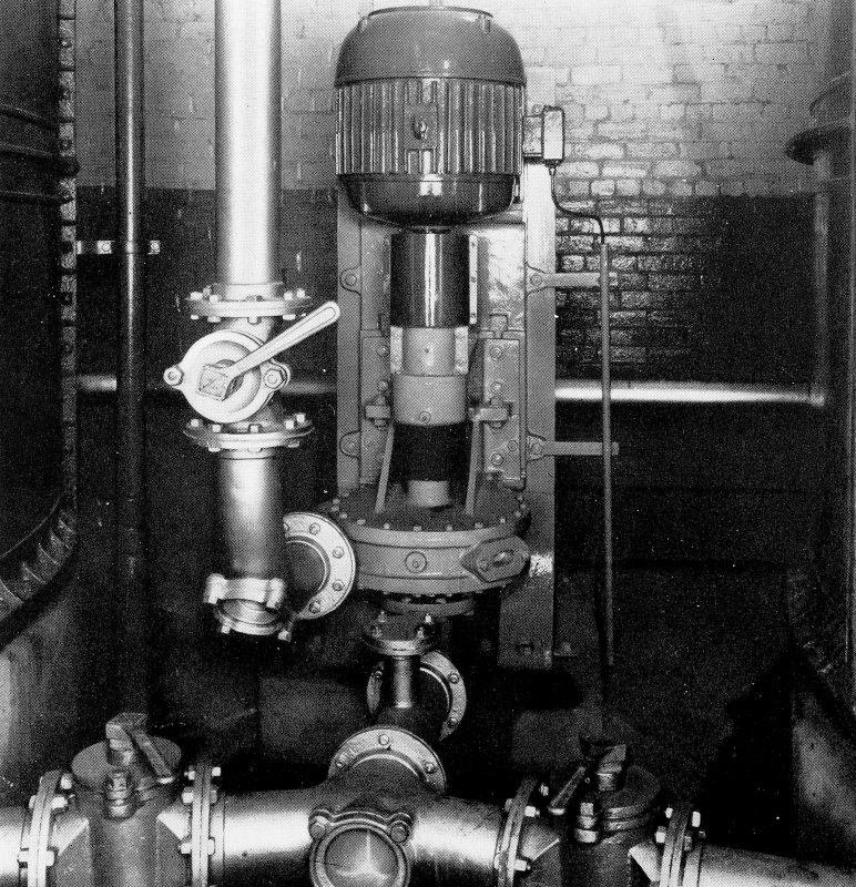 Copy of photograph of paper making machine (no.6), vertical type stock pump which draws fom the bottom of the chests and discharges into a constant level headbox ensuring a a steady flow through the plant to the machine. A HOPKINSON consistency Regulator takes care of any stock density variations, from the JB&S Machine 161 catalogue, James Bertram and Son Ltd, Leith Walk, Edinburgh, circa 1953. The catalogue describes and illustrates some of the features of the No 161 machine 'recently installed at the well known Mill of Guard Bridge Paper Co Ltd, Fife , Scotland designed with the co-operation of the Mill Staff especially for the economical production of the highest quality papers...'
