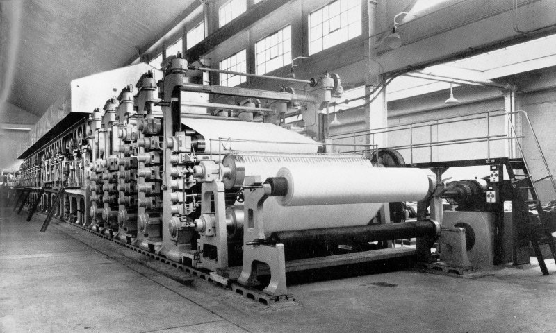 Copy of photograph of paper making machine (no.6), general views,  from the JB&S Machine 161 catalogue, James Bertram and Son Ltd, Leith Walk, Edinburgh, circa 1953. The catalogue describes and illustrates some of the features of the No 161 machine 'recently installed at the well known Mill of Guard Bridge Paper Co Ltd, Fife , Scotland designed with the co-operation of the Mill Staff especially for the economical production of the highest quality papers...'