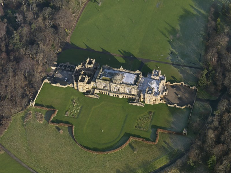 Oblique aerial view centred on the country house, taken from the WSW.