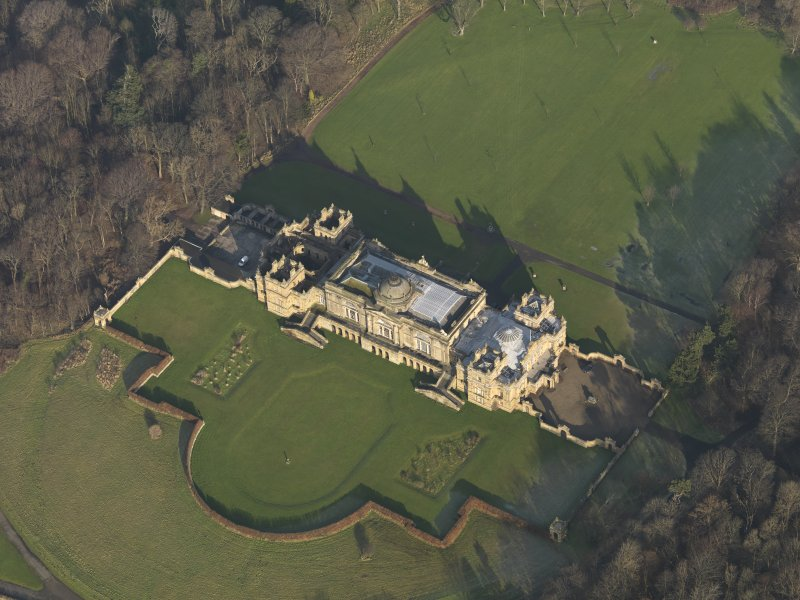 Oblique aerial view centred on the country house, taken from the SW.