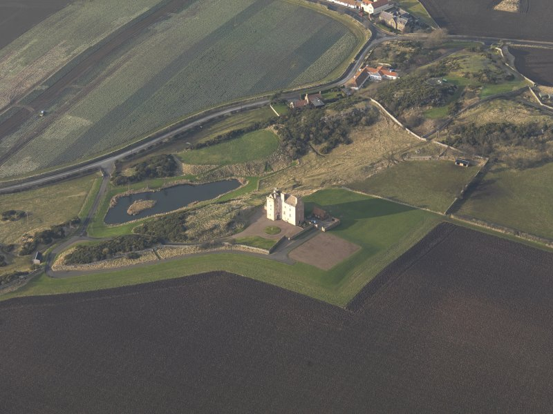 Oblique aerial view centred on the tower house, taken from the SE.