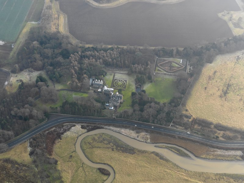 Oblique aerial view centred on the country house with the gardens adjacent, taken from the N.