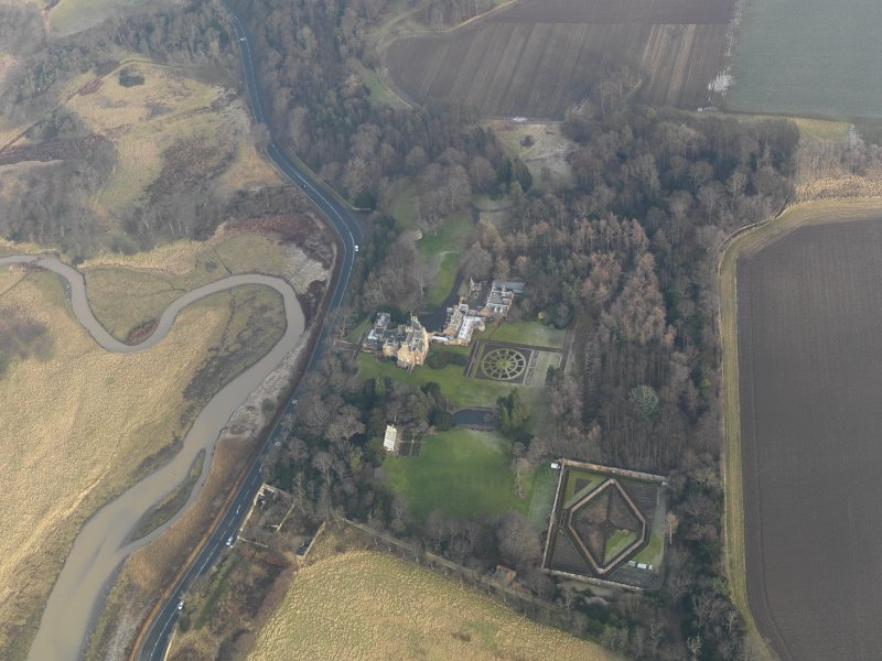 Oblique aerial view centred on the country house with the gardens adjacent, taken from the WSW.