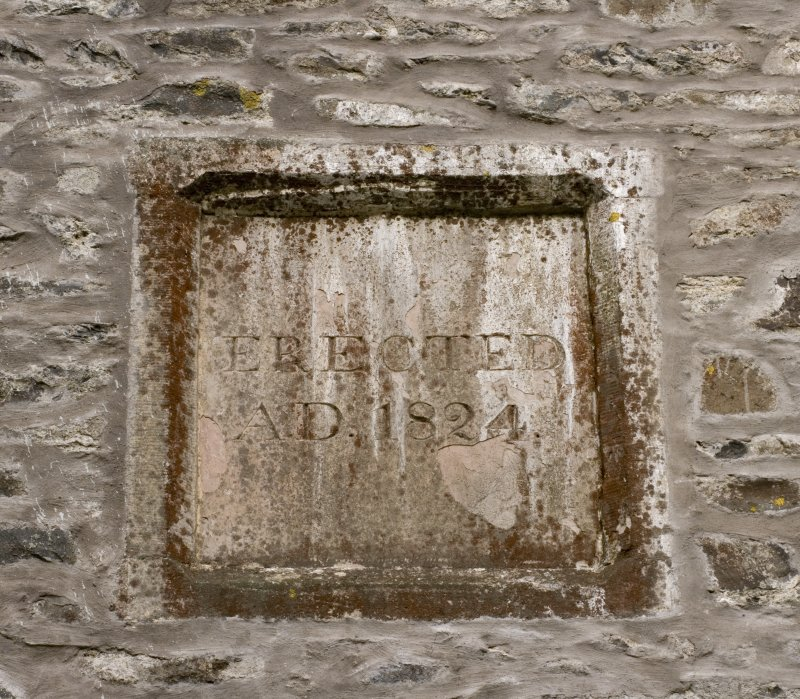 Detail of 1824 date plaque in south wall of west tower at the Parish Church of Ettrick & Bucceleuch, commemorating the construction of the current building