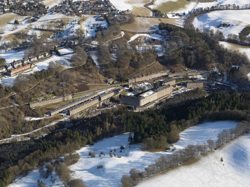 Oblique aerial view centred on the mill village New Lanark in the snow, taken from the South-West.