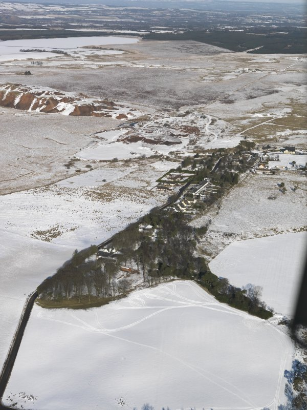 General oblique aerial view of the village and the shale oil works bings, taken from the S.