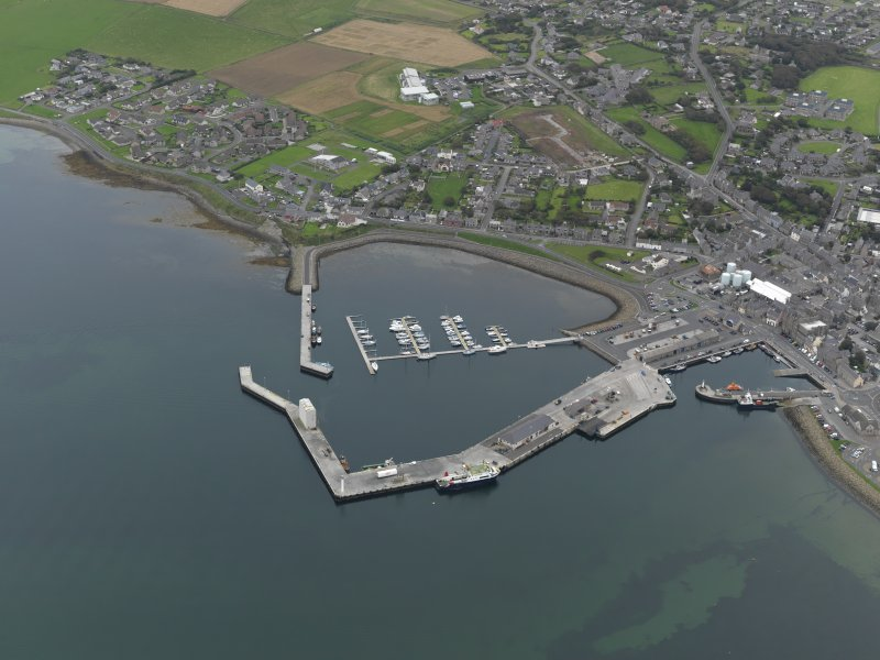 Oblique aerial view centred on the harbour, taken from the WNW.