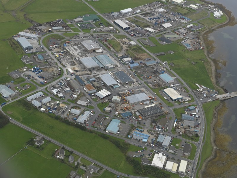 Oblique aerial view centred on the airfield and industrial estate, taken from the SSE.