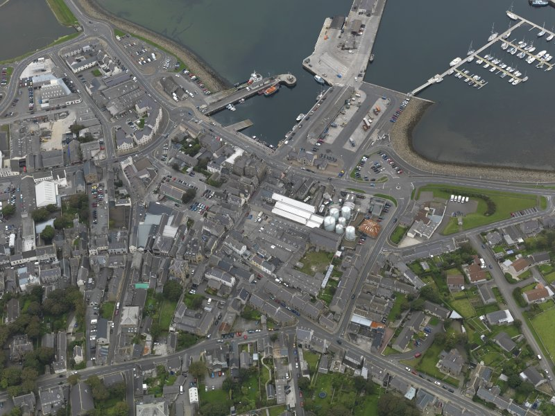 Oblique aerial view centred on the harbour area, taken from the SE.