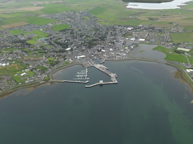 General oblique aerial view centred on the harbour with the town adjacent, taken from the N.