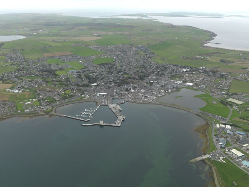 General oblique aerial view centred on the harbour with the town adjacent, taken from the NNW.