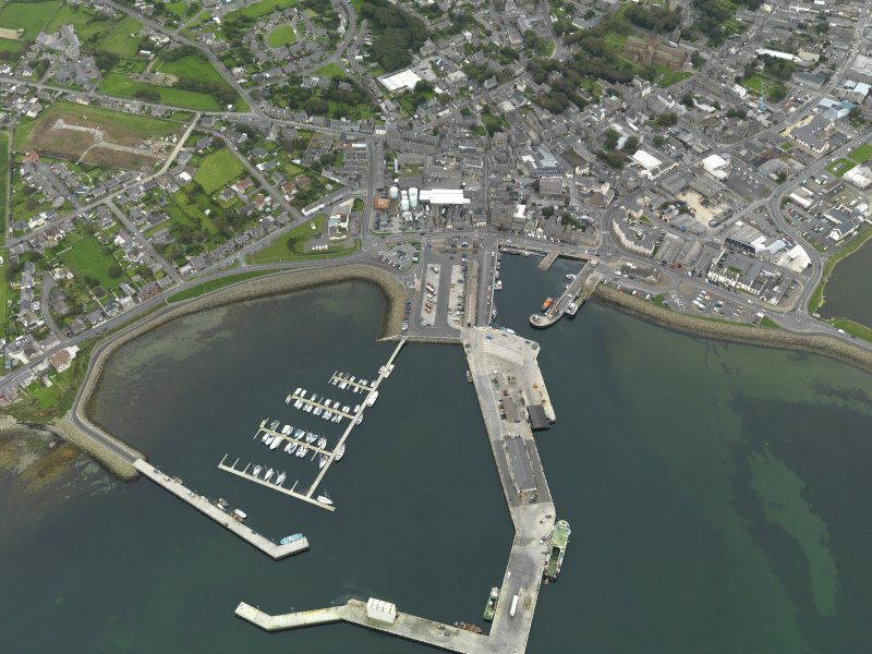 Oblique aerial view centred on the harbour with the town adjacent, taken from the NNW.