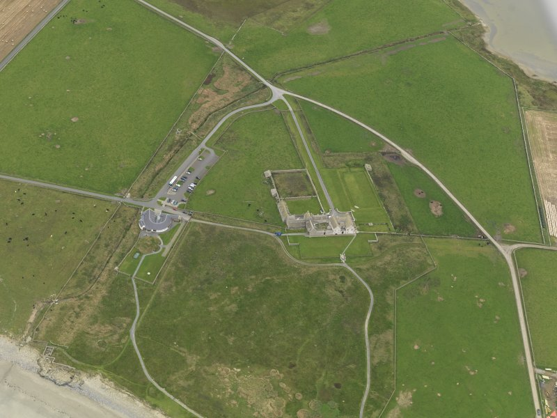 General oblique aerial view centred on the house with the visitor centre adjacent, taken from the NW.