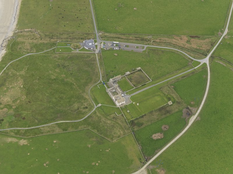 General oblique aerial view centred on the house with the visitor centre adjacent, taken from the SSW.