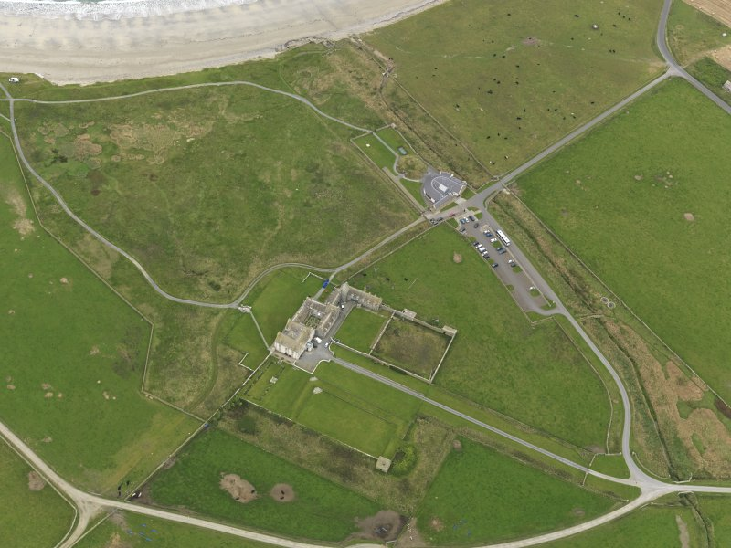 General oblique aerial view centred on the house with the visitor centre adjacent, taken from the S.