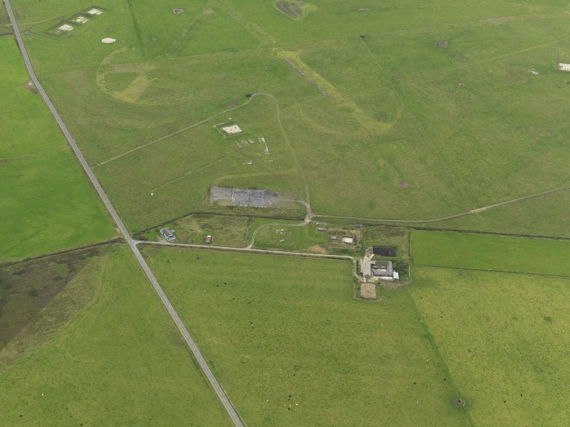 Oblique aerial view centred on the NE area of the airfield, taken from the NNE.