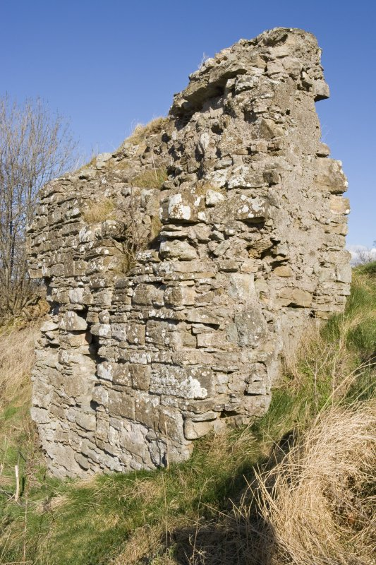 External face of fragment of N curtain beside the NW mound of the Henry VIII fort