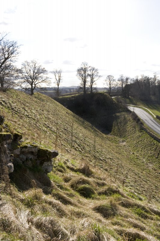 View along the N face of the castle mound from E showing the ditch