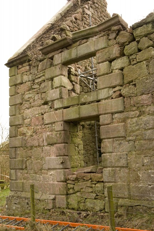 Detail of blocked doorway with window above at E end of N elevation at Dalton Old Parish Church