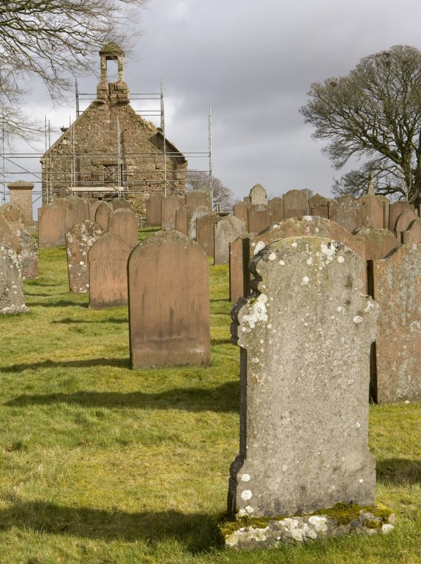 View looking E across graveyard to the W gabled elevation of Dalton Old Parish Church