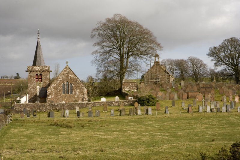 View looking E across graveyard, showing the ruinous Dalton Old Parish Church in relation to the present Dalton Parish Church