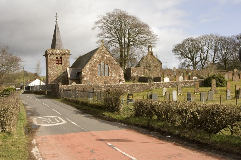 View looking W from road into Dalton, showing Dalton Parish, with ruinous Dalton Old Parish Church beyond