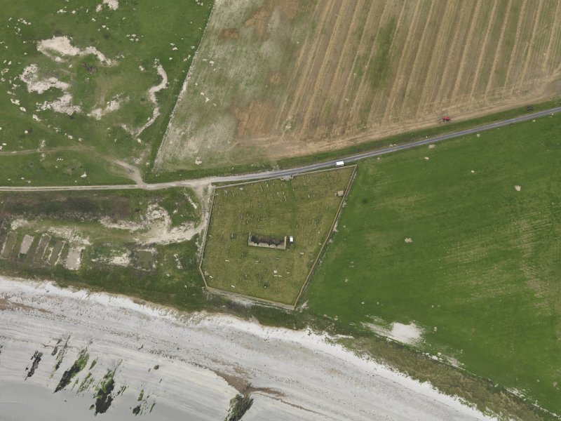 Oblique aerial view centred on the remains of the church, taken from the S.