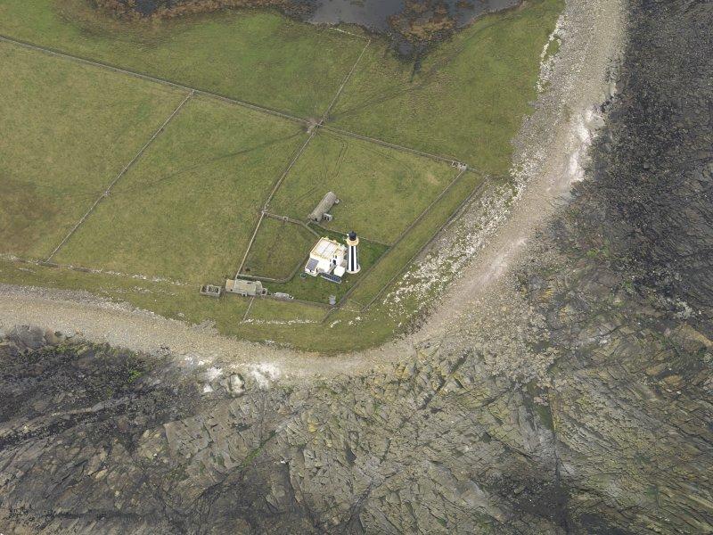 Oblique aerial view centred on the lighthouse, taken from the SE.