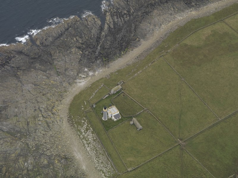 Oblique aerial view centred on the lighthouse, taken from the NNE.