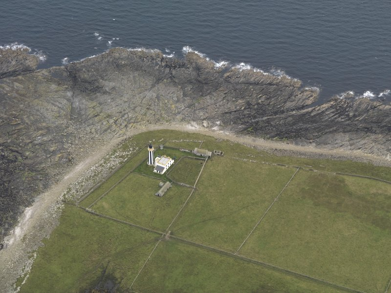 Oblique aerial view centred on the lighthouse, taken from the NNW.