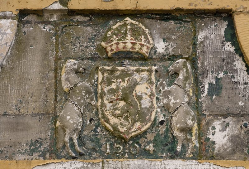Detail of the Royal Coat of Arms dated 1564 on archway adjacent to the lighthouse from WNW.