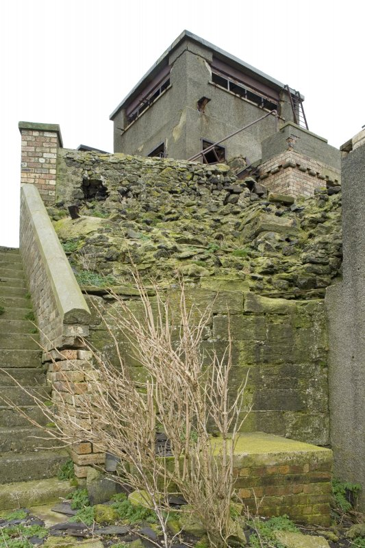 View of possible surviving section of 16th century wall below  the Port War Signal Station from the SW.