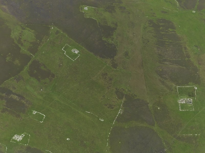 Oblique aerial view centred on the remains of the farmsteads, field systems and head dykes, taken from the NW.