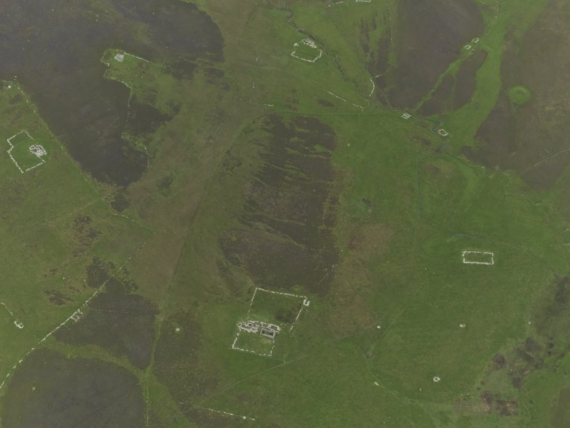 Oblique aerial view centred on the remains of the farmsteads, field systems and head dykes, taken from the WNW.