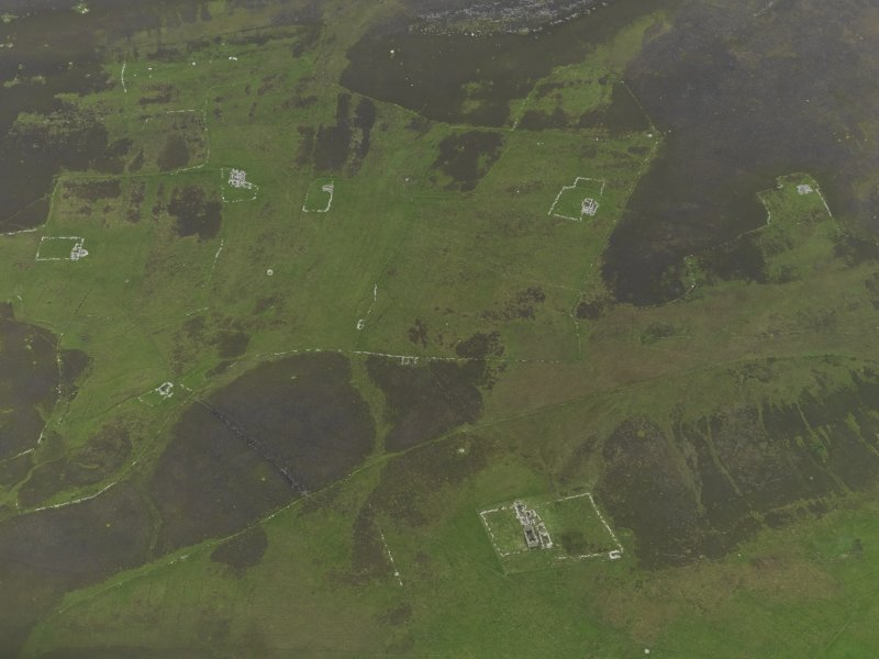 Oblique aerial view centred on the remains of the farmsteads, field systems and head dykes, taken from the WSW.