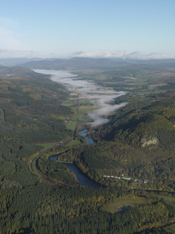 General oblique aerial view looking along a mist-shrouded River Tay, taken from the S.