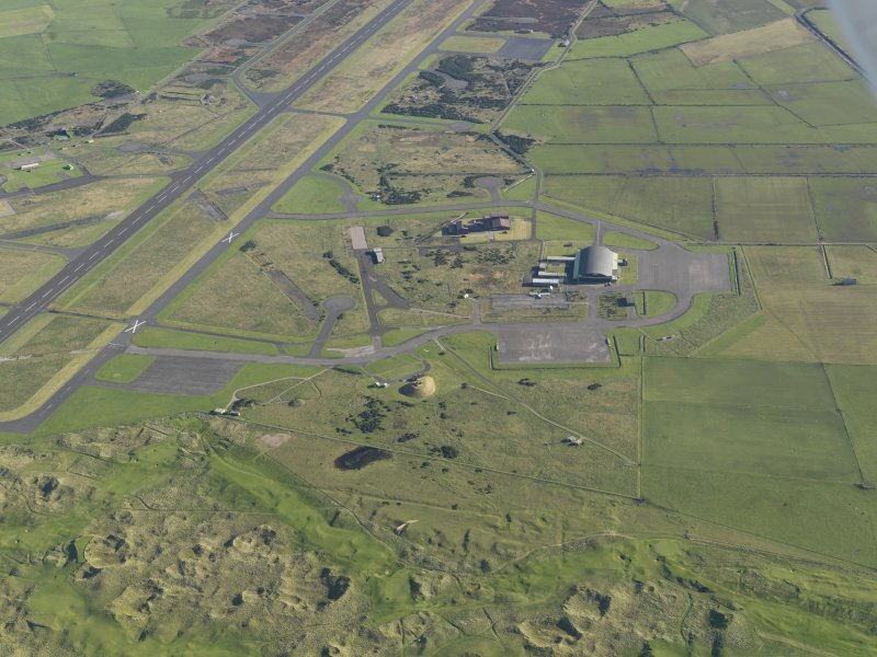 Oblique aerial view of the hangar at Machrihanish Airfield, taken from the SW.